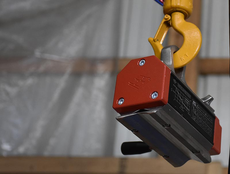 magnet and hook of a lift crane system