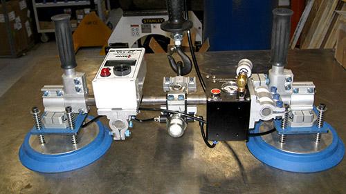 Moving metal Winnipeg Vacuum attachment crane jib lift