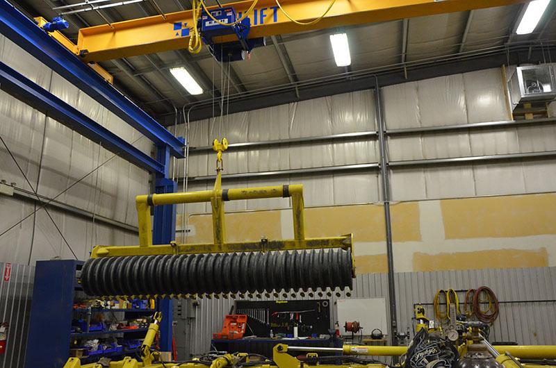 shop bay with a overhead bridge crane in regina, saskatchewan hook hoist install design service