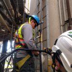 suiting up fall arrest long climb tower jib crane