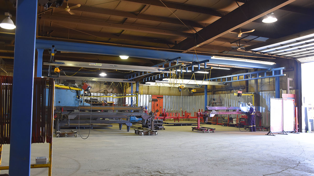 acculift crane system over welding work stations at ag manufacturing facilities